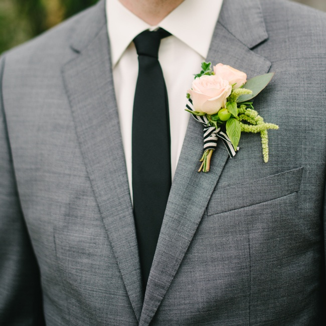 Geoff adorned his lapel with a blush pink rose boutonniere  accented with green astible and tied with a black and white striped ribbon that matched Sarah's bouquet wrap.