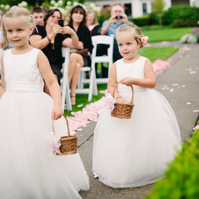 The flower girls wore white ball gown-style dresses that made them look like they were floating down the aisle.