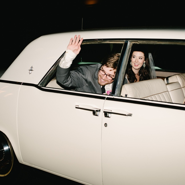 The couple made their getaway in a white vintage Lincoln Continental.