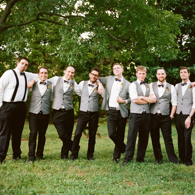 Daniel's groomsmen wore gray vests with purple and gray plaid bowties.