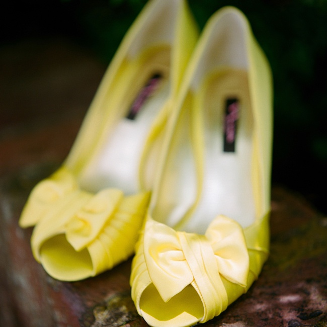 Heather wore satin yellow peep-toe Nina heels with bow detailing down the aisle.