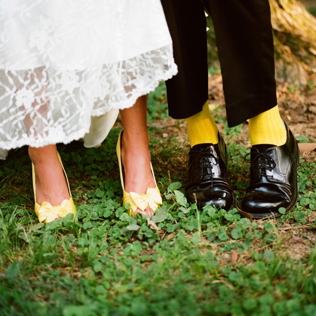 The bride and groom both sported a pop of yellow on their feet with their shoes and socks.