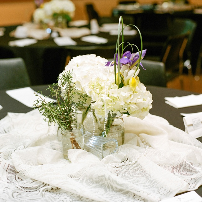 The reception centerpieces were made of hydrangeas and orchids and placed in repurposed jars, surrounded by lace.