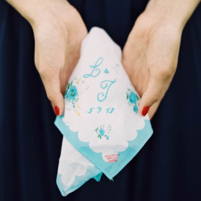 The couple had a special embroidered handkerchief made with their initials and wedding date.