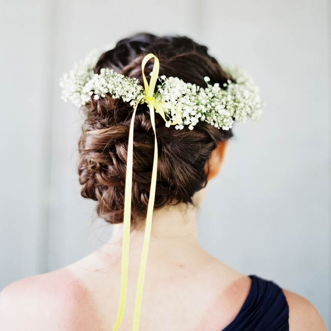 Bridesmaids wore floral crowns of baby's breath atop their heads during the ceremony.