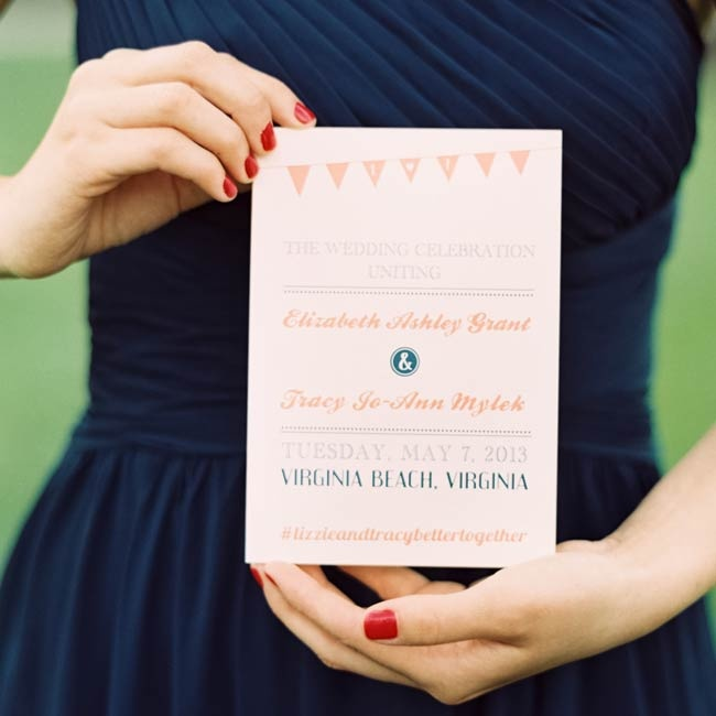 Ceremony programs played on the couple's pennant theme and used their peach and navy color palette.