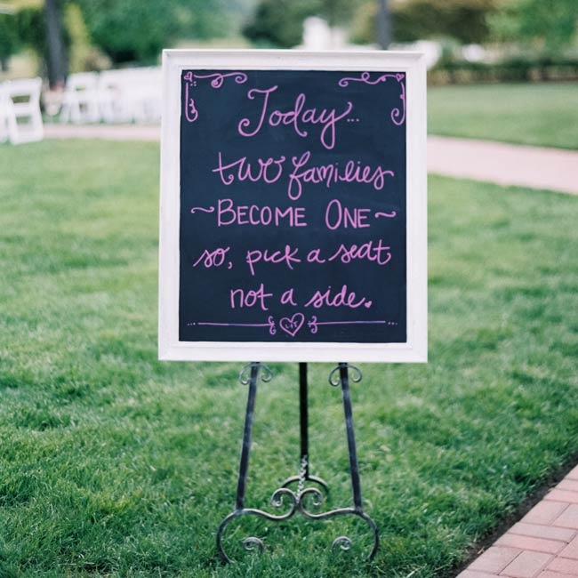 "The couple opted not to seat guests according to sides, and wrote a chalkboard note telling guests to ""pick a seat, not a side."""