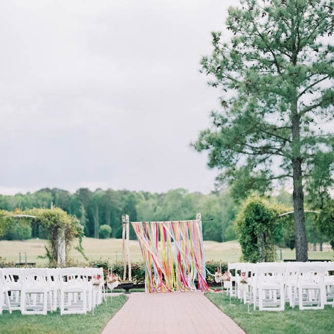 The couple exchanged vows in a colorful outdoor ceremony at The Signature at West Neck in Virginia Beach, VA.