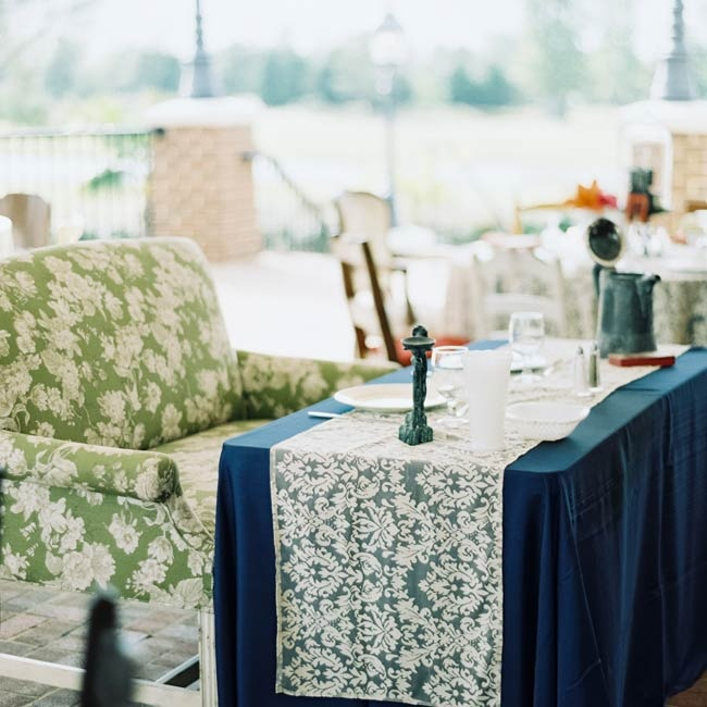The couple sat on a love seat at their sweetheart table for the reception dinner.