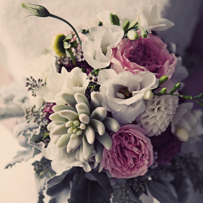 The bride's bouquet was full of white dahlias and lisanthuses, green succulents and pink peonies.