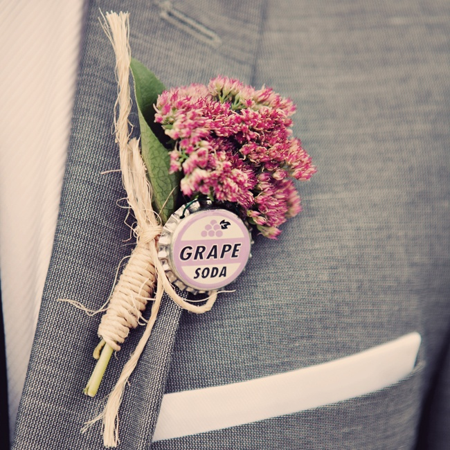 The groom sported a pink boutonniere wrapped in twine and accented with a vintage grape soda bottle cap.
