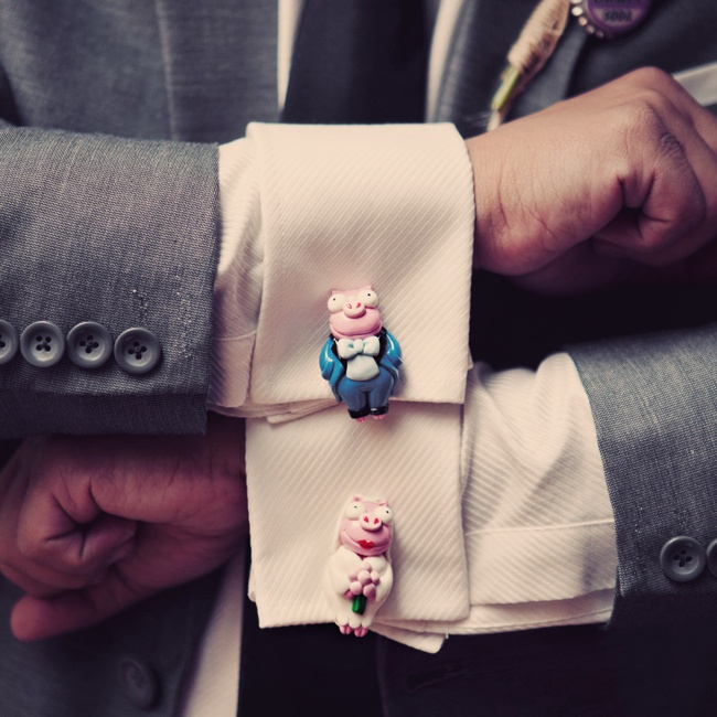 The groom donned these quirky bride and groom vintage piglet cufflinks.