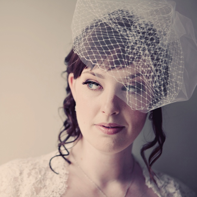 Amanda chose to go with a more vintage look and opted for a birdcage veil to complete her hairstyle.