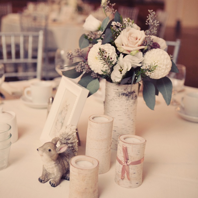 Each table had a Beatrix Potter woodland character theme and centerpieces were comprised of birch-inspired vases.