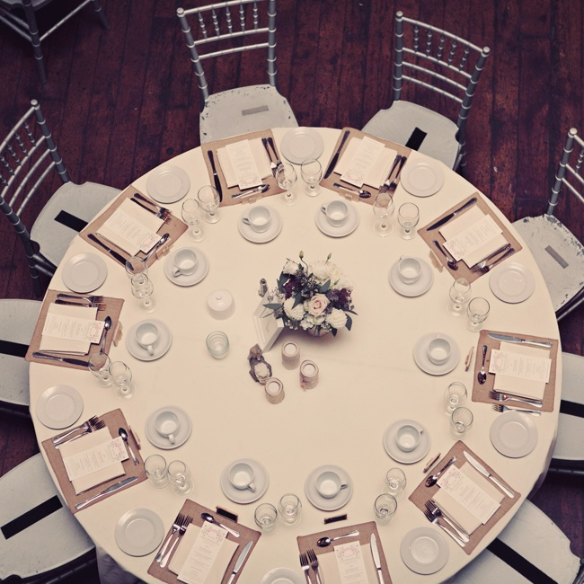 The tablescape was set with neutral decor and silver Chiavari chairs.