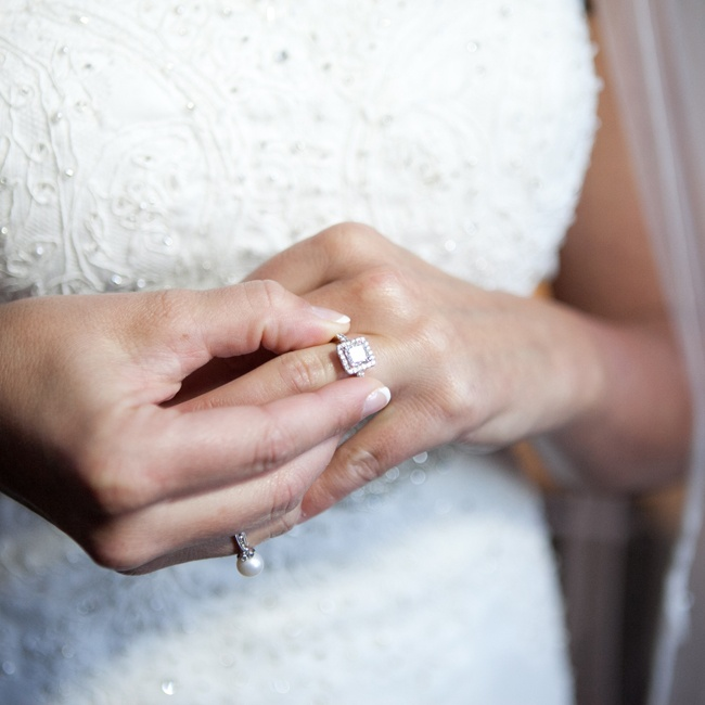 The bride's engagement ring featured a square cut diamond in a halo setting.