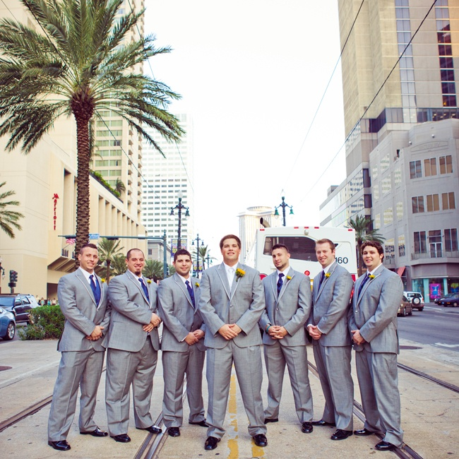 Groomsmen wore light gray suits with matching blue ties and yellow boutonnieres.