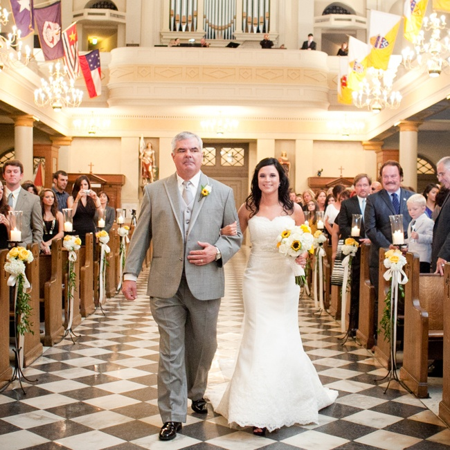 Ashley's father walked her down the aisle at St. Louis Cathedral in New Orleans, LA.