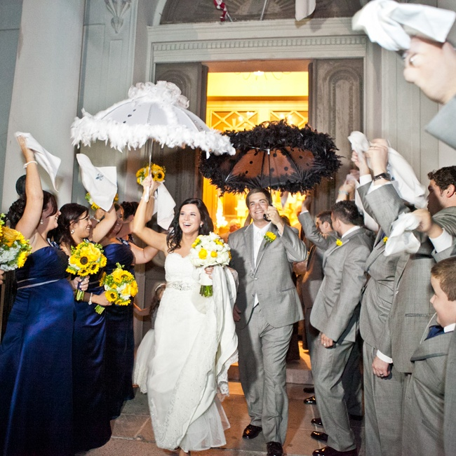 The couple exited their church ceremony and began the traditional New Orleans Second Line bridal parade.