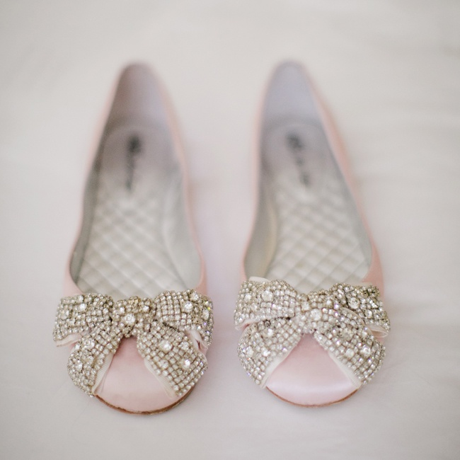 The bride stayed comfortable walking down the aisle with these embellished blush bridal flats.