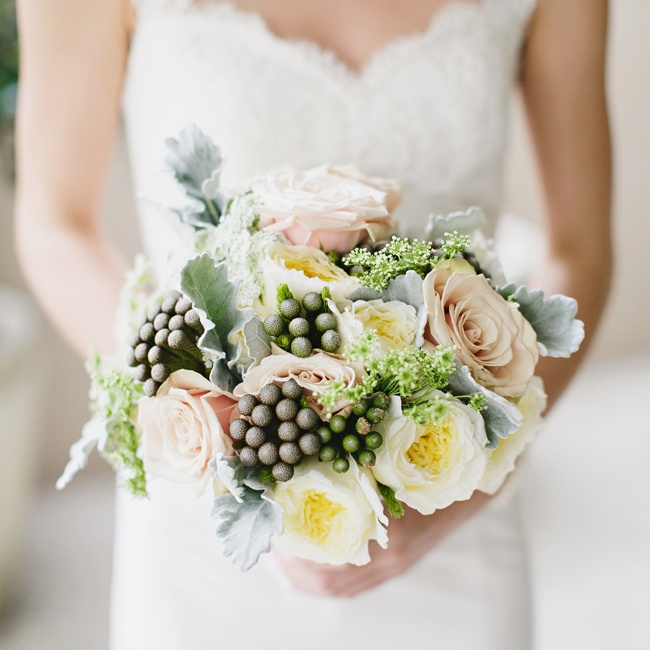 Emily mixed traditional roses and peonies with textured berzelia and lamb's ear in her bridal bouquet.