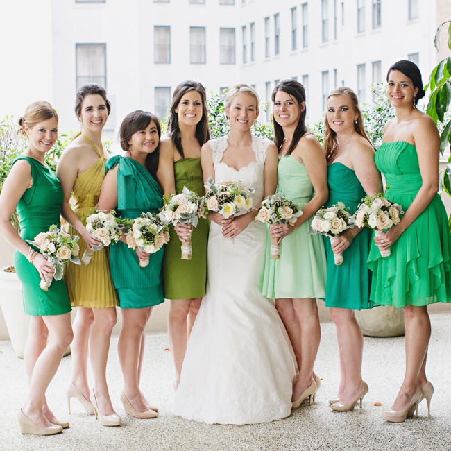 Bridesmaids got to choose any style and shade of green for their short dresses.