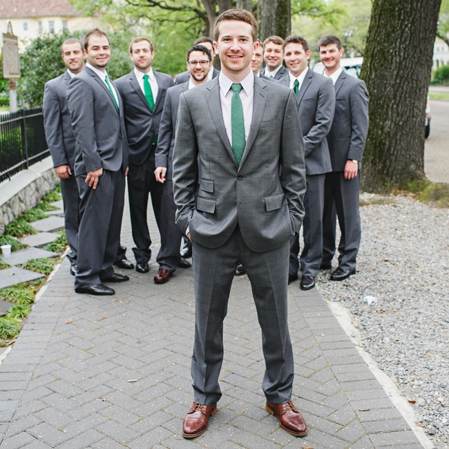 Jon's groomsmen donned gray suits with matching forest green ties for the ceremony.