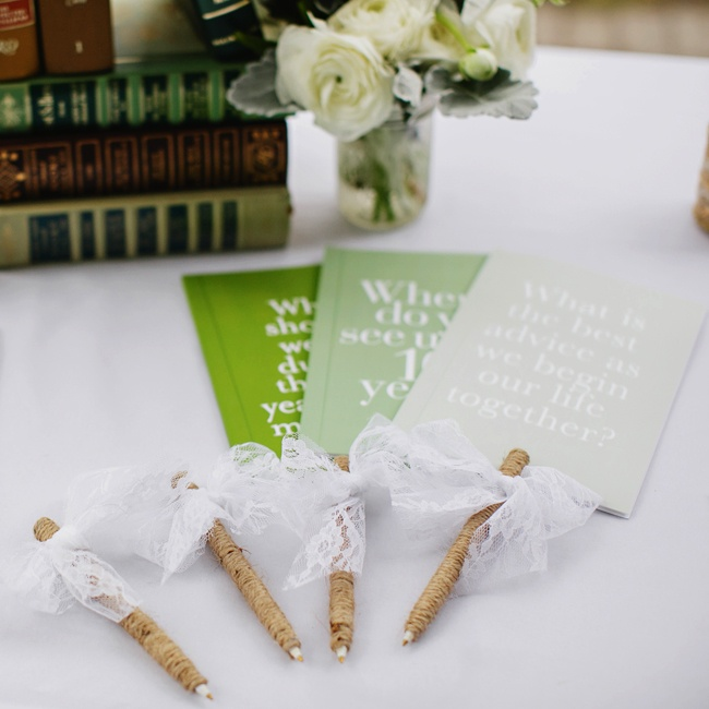 Guests signed these cards in various shades of green with loving words of advice for the bride and groom.