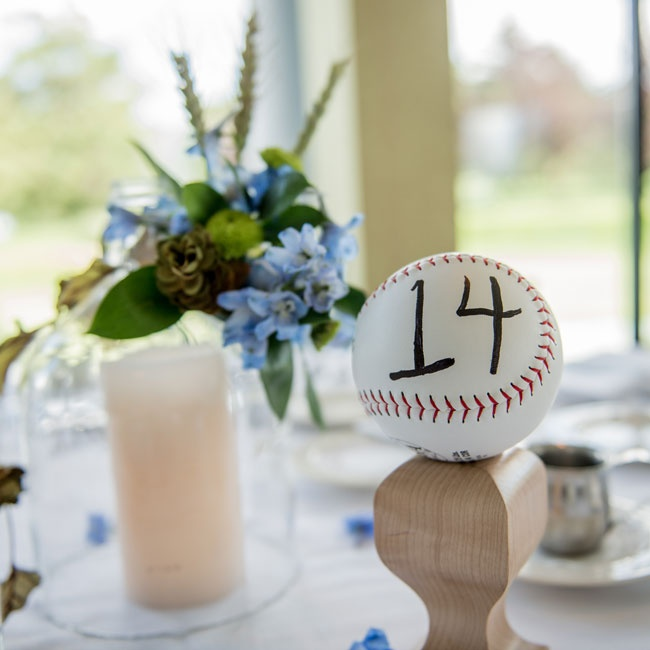 Tables were marked by numbered baseballs displayed on wooden pedestals.