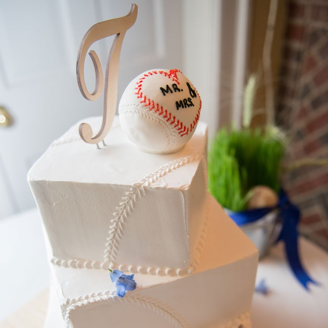 "The couple's three-tiered buttercream cake featured piping that resembled the stitching on a baseball. The cake was topped by a baseball with heart-shaped stitching that read ""Mr. & Mrs"" and a silver T for the couple's last name."