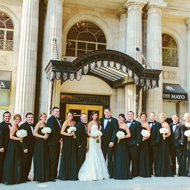 The couple went for a sophisticated vibe with a black and white color palette. Bridesmaids wore formal-length black, strapless gowns.