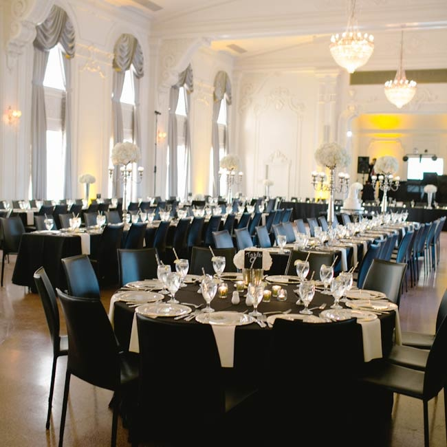 The reception space presented an elegant air in a white room with silver drapes and hanging chandeliers.