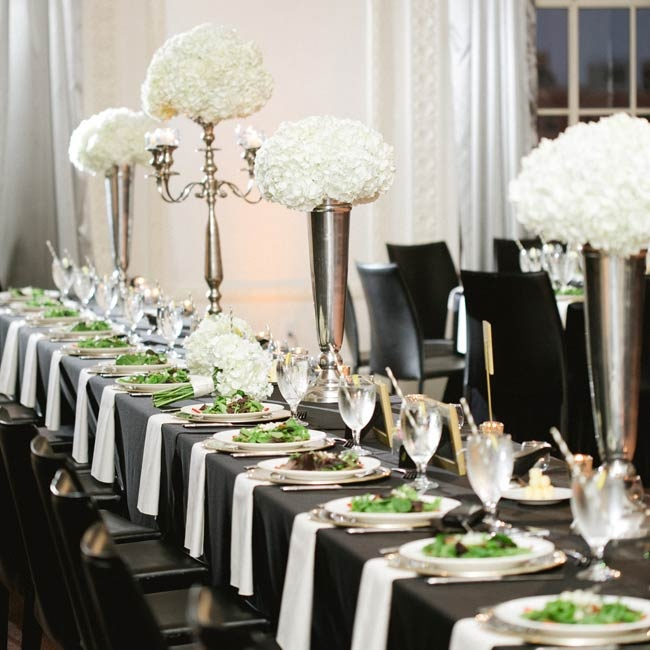 Tables were set with sophisticated black tablecloths, white linens and large, silver vases and candelabras.