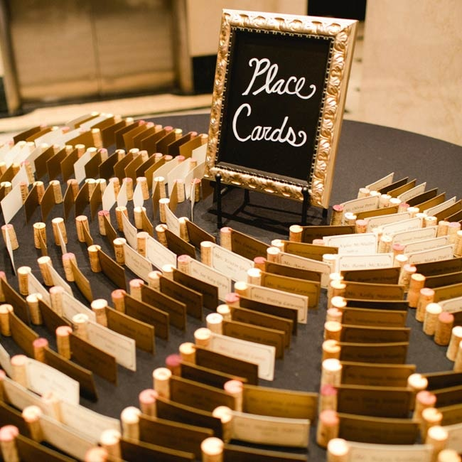 Escort cards were made out of varying shades of card stock and slid into wine corks.