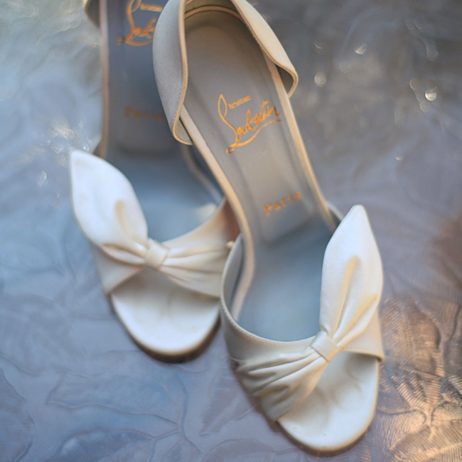 Jessica's bridal shoes were a pair of ivory Christian Louboutin pumps with ladylike bow embellishments.