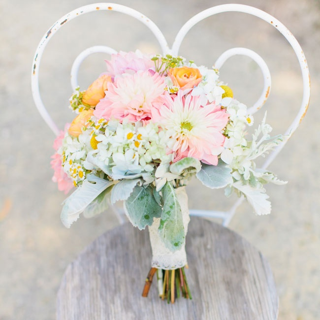 Bex carried a bouquet of pastel blooms in pinks and oranges down the aisle on her wedding day.