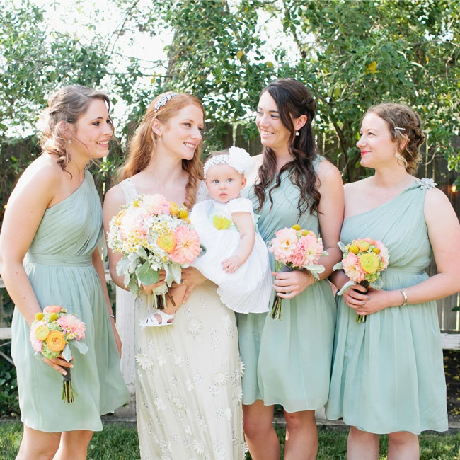 Bex's bridesmaids wore light, neutral green, short dresses with one-shoulder detailing.