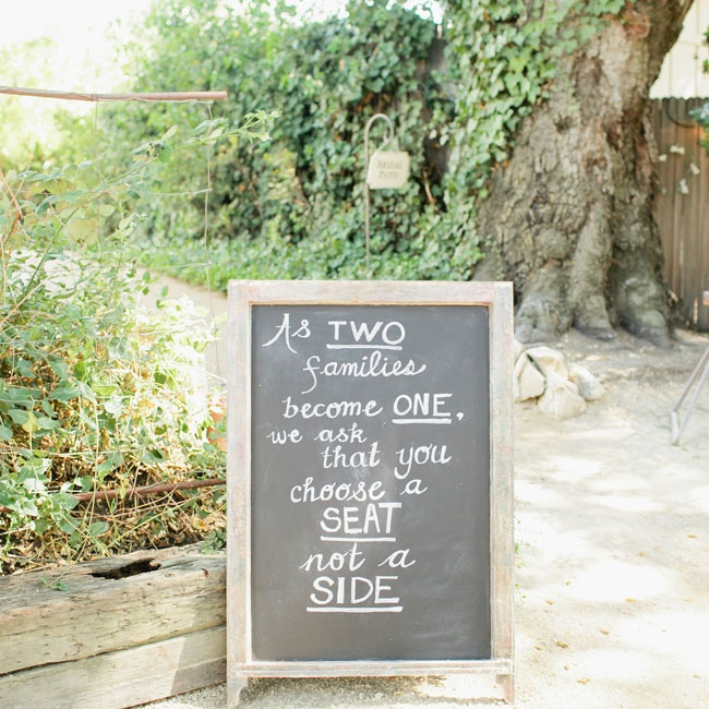 """Families were asked to """"choose a seat, not a side"""" during the wedding ceremony."""