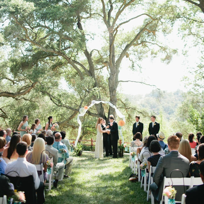 The couple exchanged vows in a forest setting at the Portola Inn in Atascadero, CA.