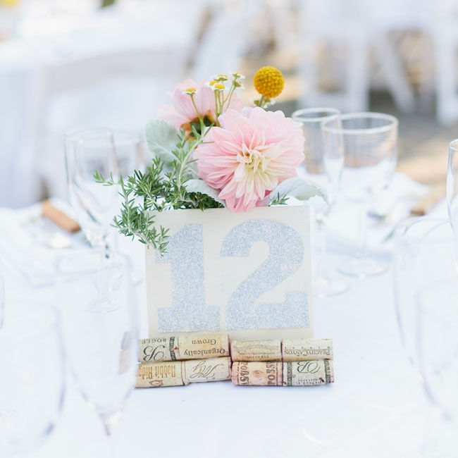 The reception table names were made from scratch with discarded wine corks and sparkly numbers.