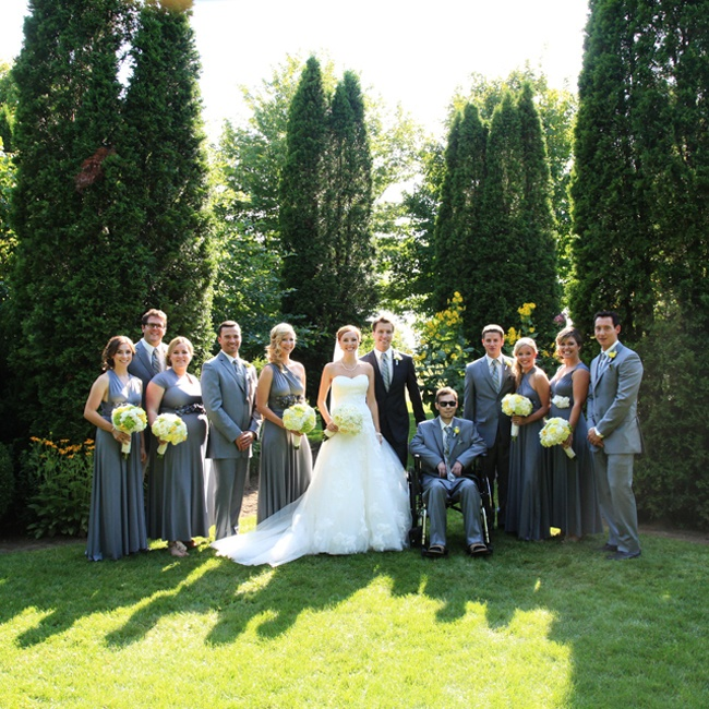 The groomsmen wore tailored gray three-piece suits with matching ties that perfectly complemented the girls' looks.