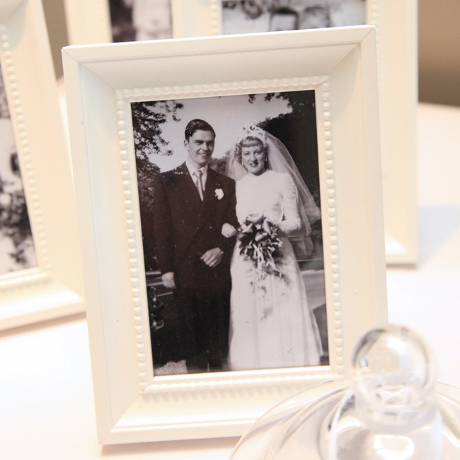 The couple incorporated vintage family wedding photos into the reception decor as a way to honor their loved ones.