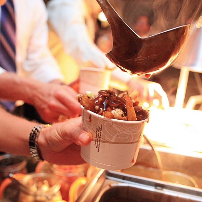 Guests whetted their appetite with a fun poutine buffet (poutine is a popular Canadian dish with french fries, gravy and cheese curds) during the reception.