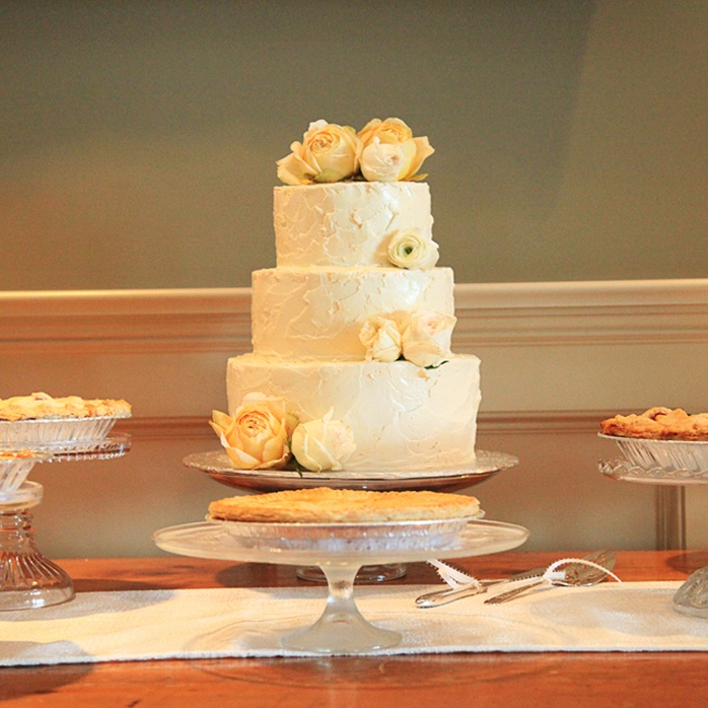 The couple's three-tiered cake was simple, yet elegant with ivory buttercream frosting and cream-colored roses.
