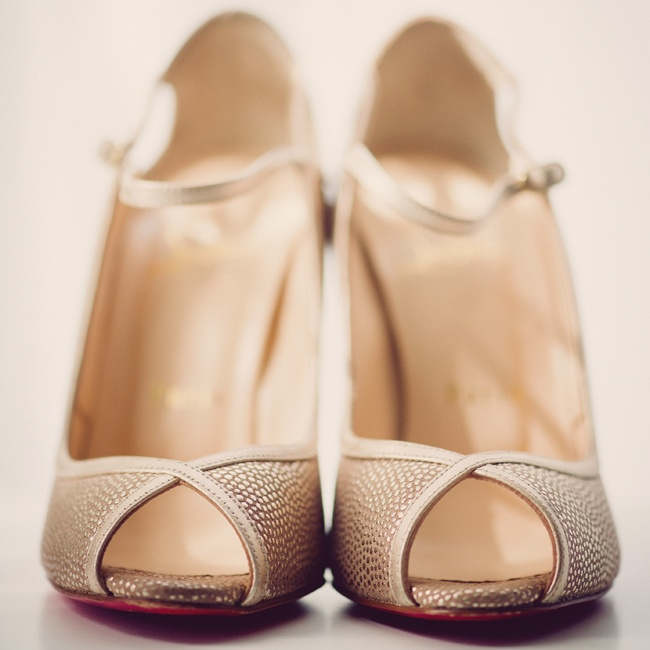 Sparkly gold Christian Louboutin heels were a glam addition to Christina's bridal ensemble.