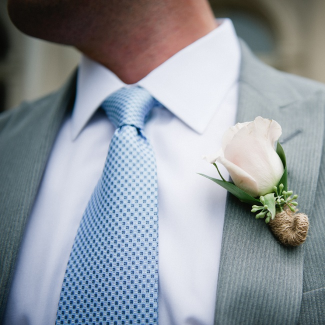 A single rose was paired with seeded eucalyptus and wrapped in burlap.