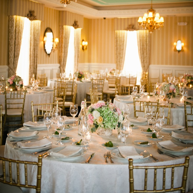 "The reception decor was kept clean and simple, with birch tea light candles and low birch containers of green hydrangeas, cream, ivory and pale pink roses and gray brunia berries. ""We kept the centerpieces low for better table visibility for our guests,"" says Christina."