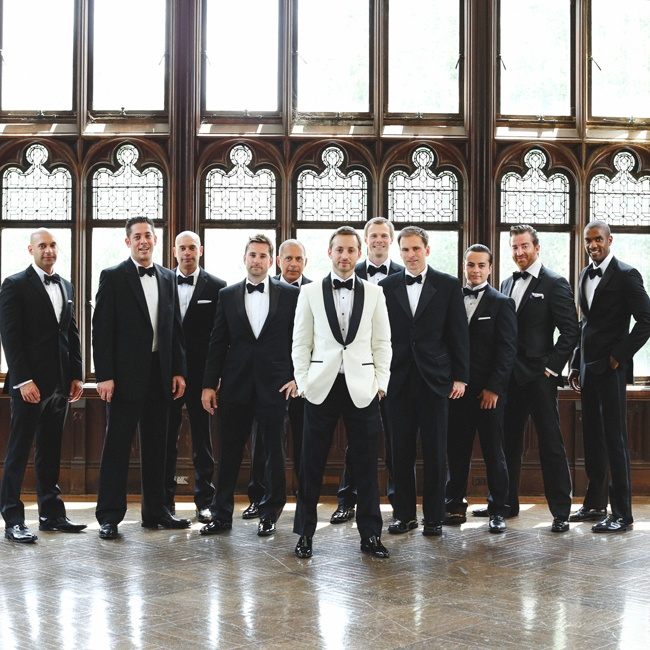 David had nine groomsmen who all wore black tuxedos with white shirts. The men also wore bowties and suspenders to complete the formal look.