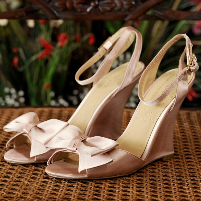 Kathleen's Pour la Victoire wedge sandals were a feminine blush pink and had bow embellishments at the toes.