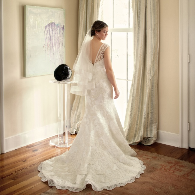 Kathleen's trumpet-style gown was adorned with scalloped-shaped lace embellishments and sheer lace straps for a look that was both romantic and feminine.